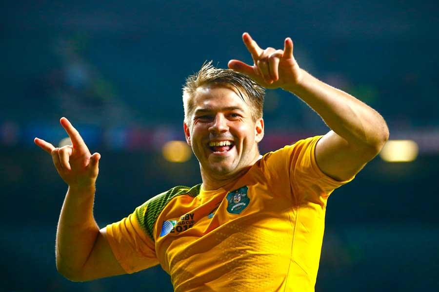 Australia's Drew Mitchell celebrates victory
