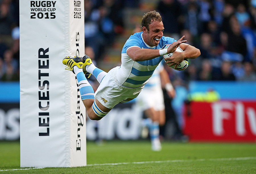 PJ van Lill of Argentina dives over to score a try