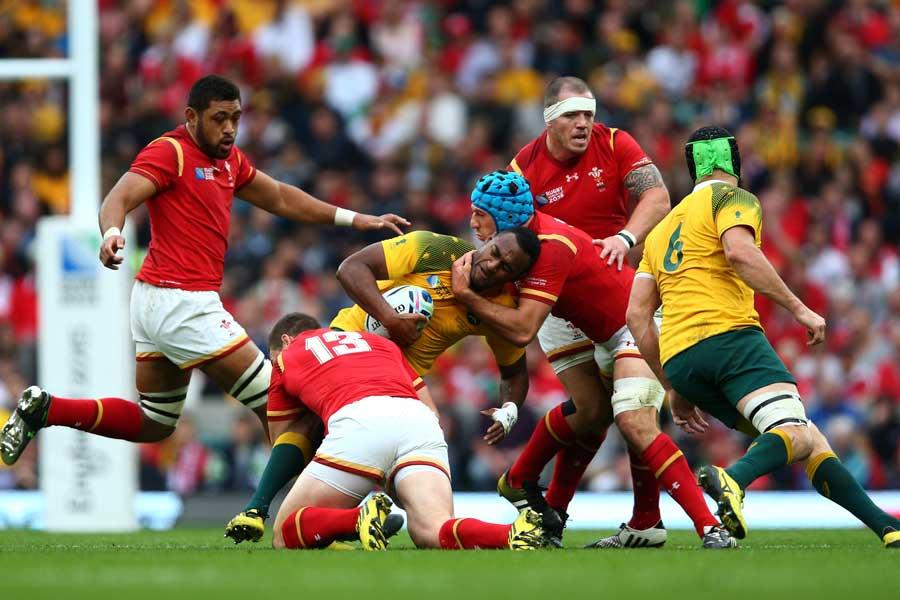 Wales' George North and Justin Tipuric tackle Tevita Kuridrani