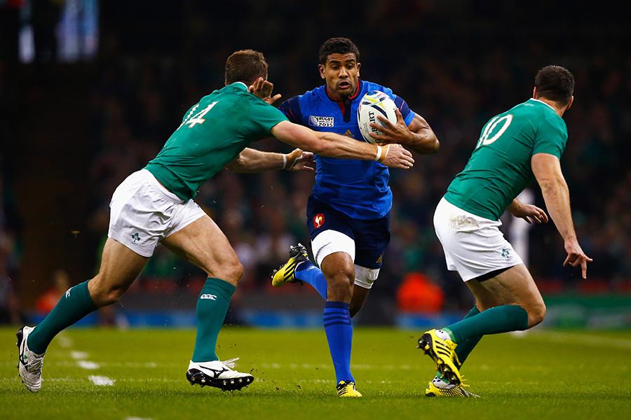 Wesley Fofana of France hands off Tommy Bowe of Ireland