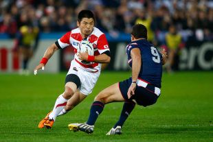 GLOUCESTER, ENGLAND - OCTOBER 11:  Fumiaki Tanaka of Japan looks to go past Mike Petri of the United States during the 2015 Rugby World Cup Pool B match between USA and Japan at Kingsholm Stadium on October 11, 2015 in Gloucester, United Kingdom.  (Photo by Julian Finney/Getty Images)