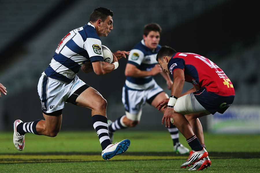 Auckland's Bryce Heem takes the ball into contact