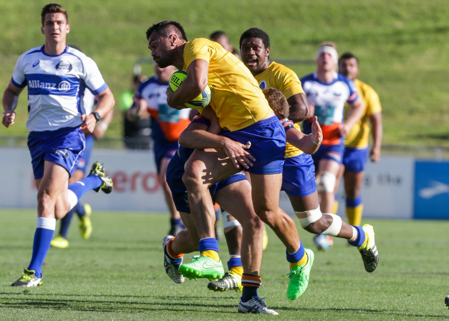 Karmichael Hunt of Brisbane City takes on the Greater Sydney Rams defence