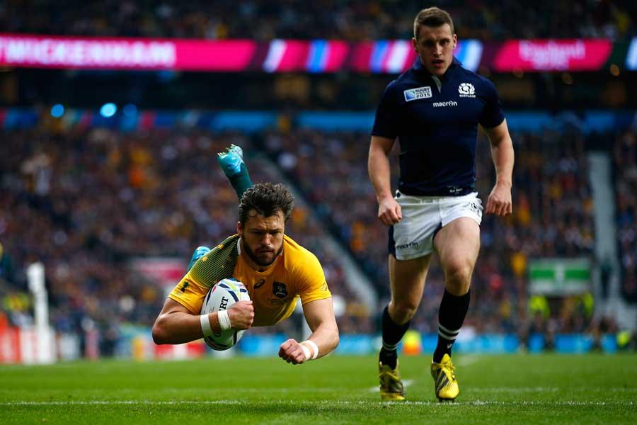 Australia's Adam Ashley-Cooper flies for a try
