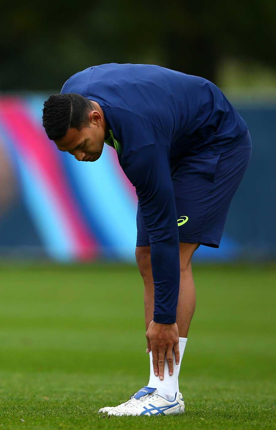 Israel Folau checks his injured ankle