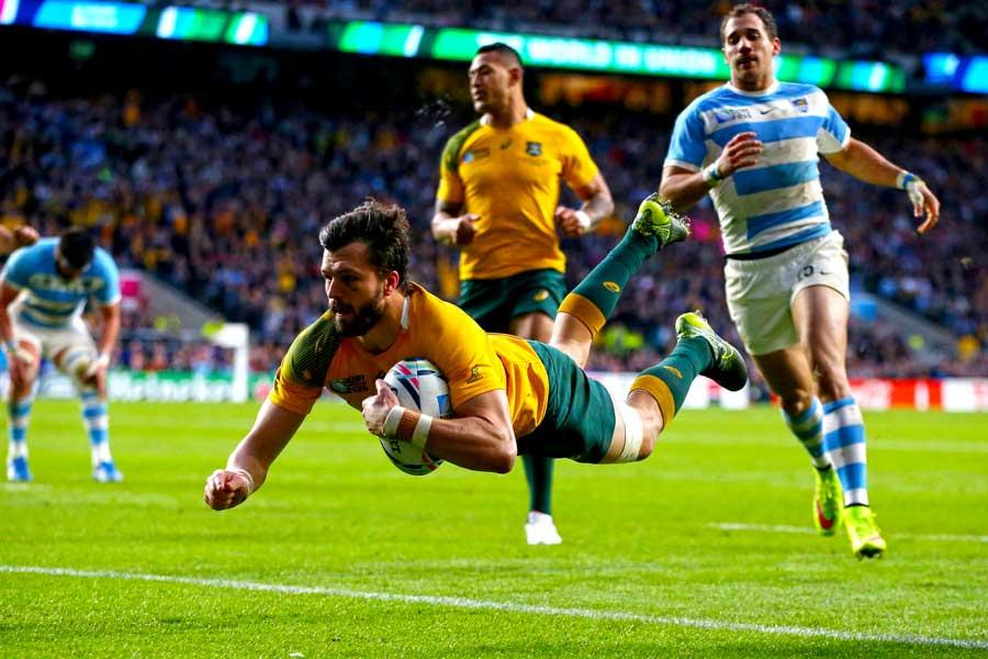 Australia's Adam Ashley-Cooper dives to score his second try