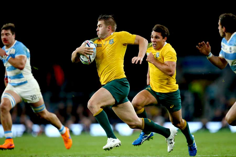 Australia's Drew Mitchell makes the break that led to the fourth try
