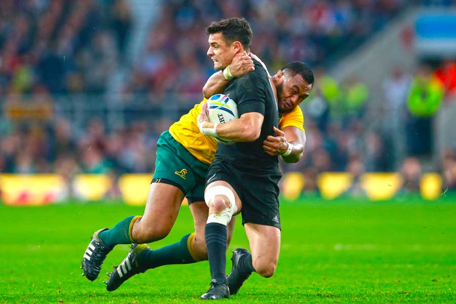 Australia's Sekope Kepu tackles New Zealand's Dan Carter