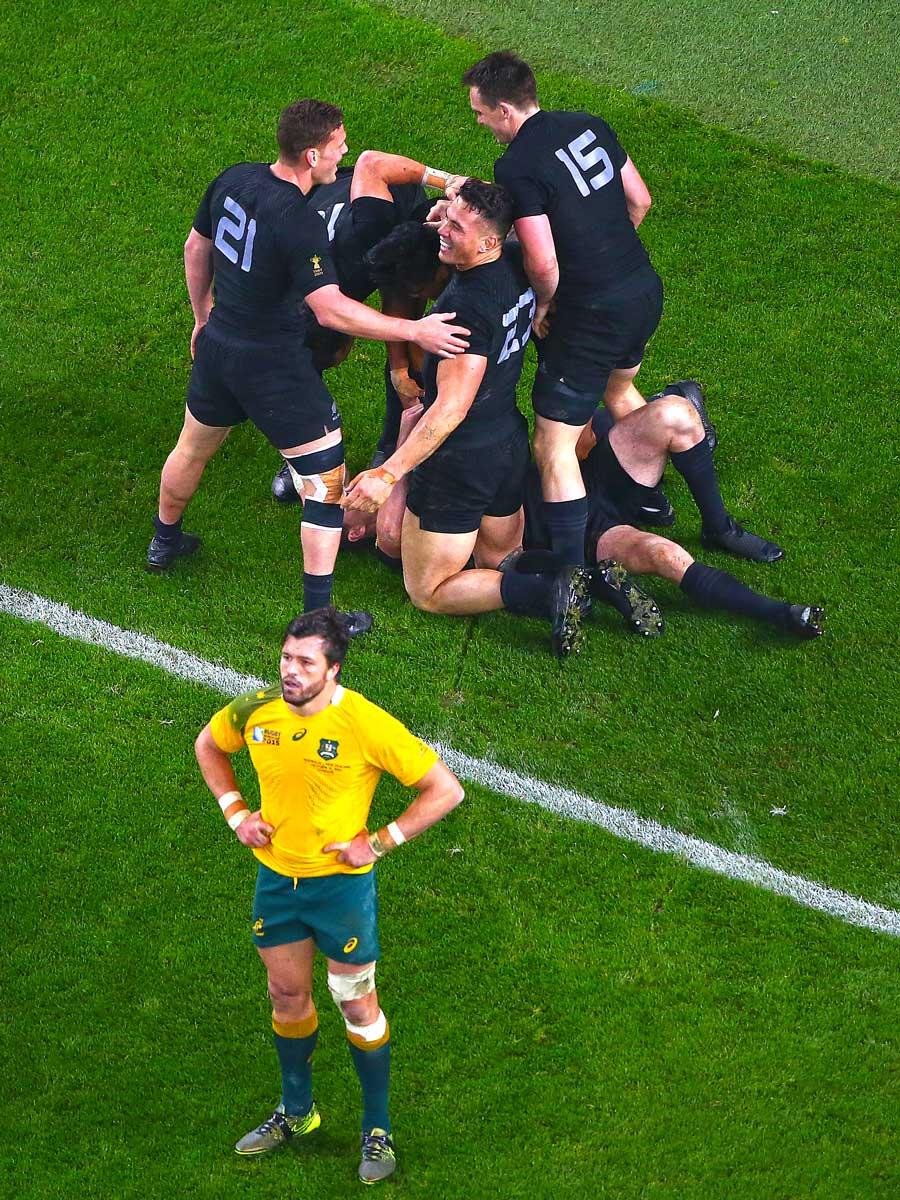 Adam Ashley-Cooper stands dejected as New Zealand congratulate Beauden Barrett on scoring the final try