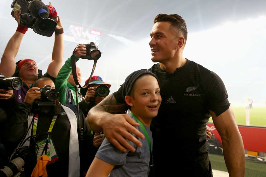 Sonny Bill Williams with Charlie Lines after giving the youngster his Rugby World Cup winner's medal