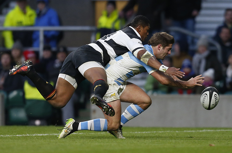 Argentina winger Santiago Cordero scores as he is tackled by Barbarians winger Waisake Naholo