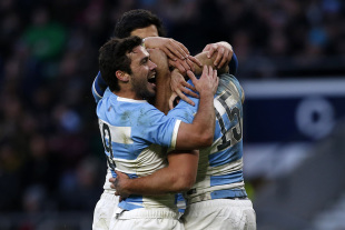 Argentinas Full Back Ramiro Moyano (R) celebrates scoring his try with Argentinas Scrum Half Martin Landajo during the International rugby union match between Argentina and the Barbarians