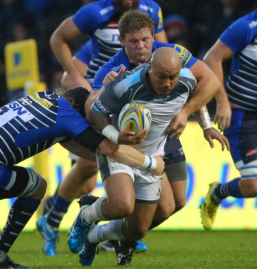 Nili Latu of Newcastle Falcons is tackled by Magnus Lund