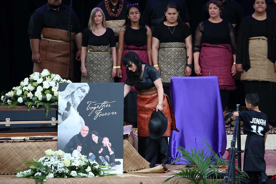 Jonah Lomu's wife, Nadene, and sons Dhyreille and Brayley Lomu attend his casket