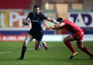 Sean Lamont of Glasgow evades Gareth Owen of Scarlets during the European Rugby Champions Cup match between Scarlets and Glasgow at the Parc y Scarlets on December 19, 2015 in Llanelli, Wales.
