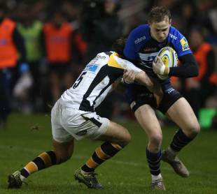 Mike Haley of Sale Sharks is tackled by Rob Miller of Wasps during the Aviva Premiership match between Sale Sharks and Wasps at the AJ Bell Stadium on January 02, 2016 in Salford, England. (Photo by Chris Brunskill/Getty Images)