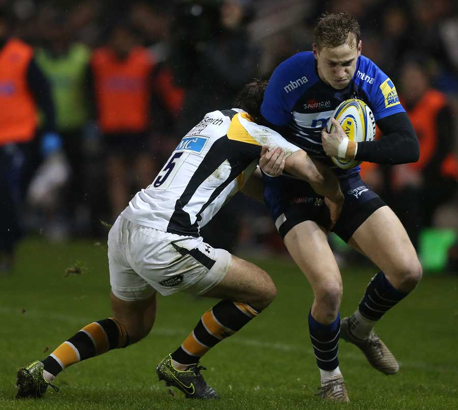 Mike Haley of Sale Sharks is tackled by Rob Miller