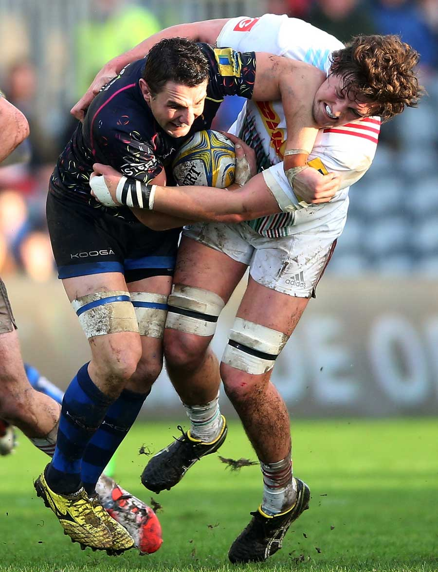 Worcester's Phil Dowson is tackled by Charlie Matthews