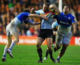 Jamie Roberts of Harlequins is tackled by Owen Farrell of Saracens during the Aviva Premiership match between Harlequins and Saracens at Twickenham Stoop on January 9, 2016 in London, England. (Photo by Steve Bardens/Getty Images for Harlequins)