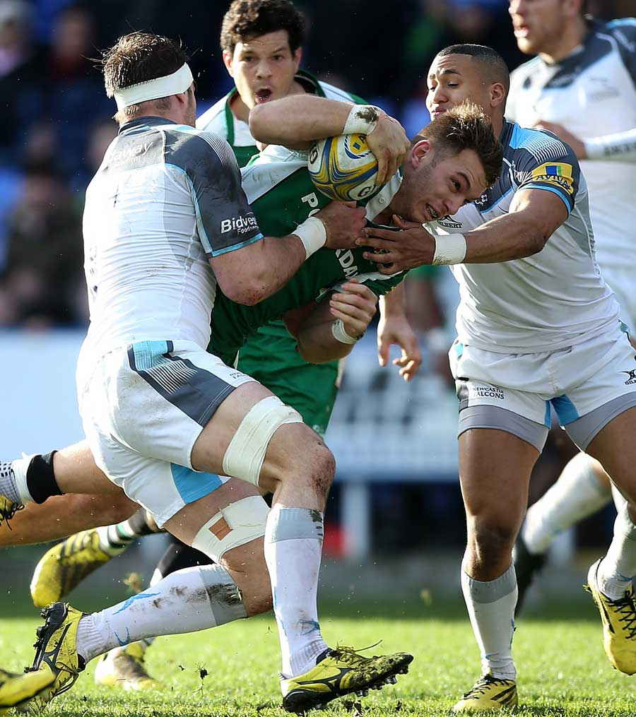 Alex Lewington of London Irish is tackled by Will Welch