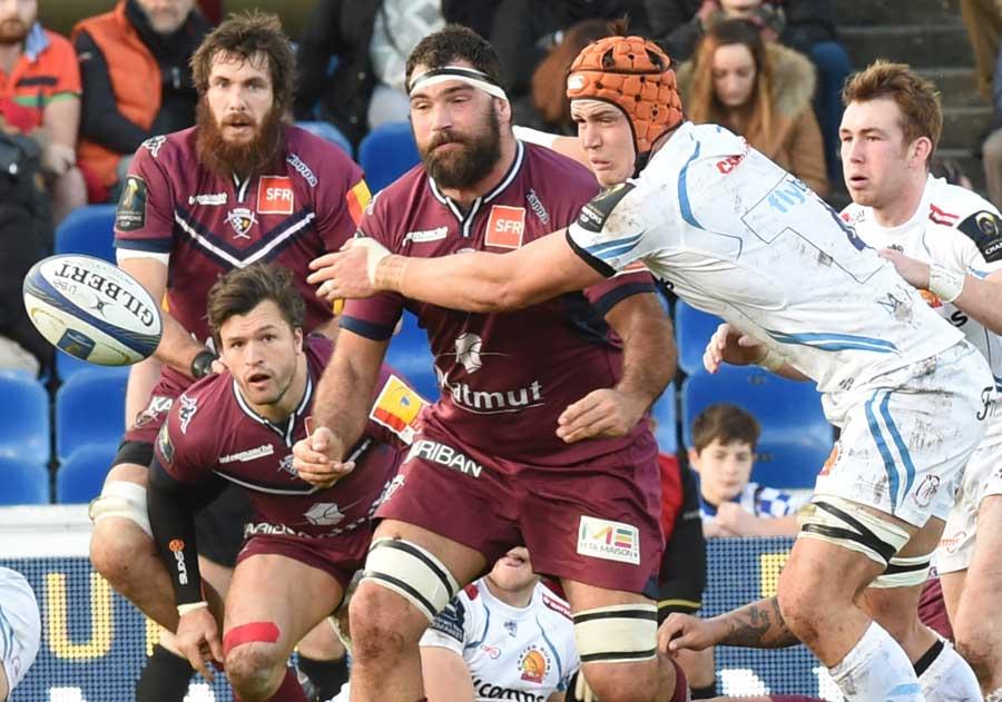 Exeter's player Ollie Atkins (R) tackles Bordeaux's Adam Jaulhac