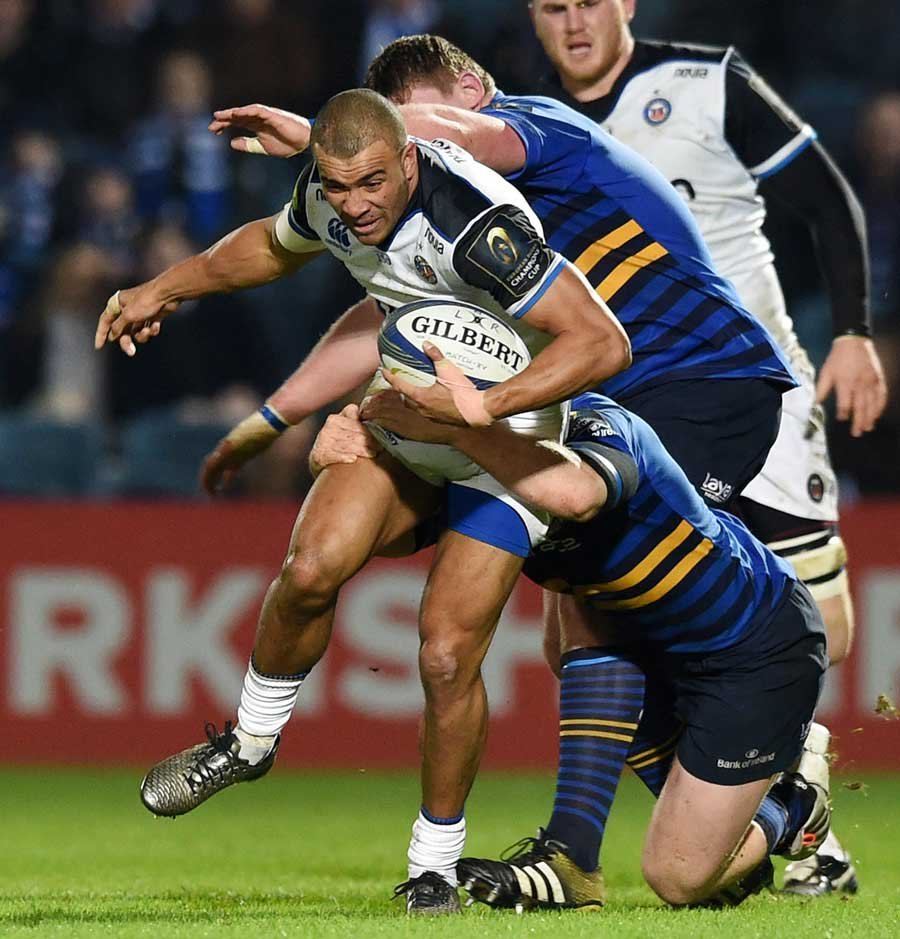 Jonathan Joseph is tackled by the Leinster defence