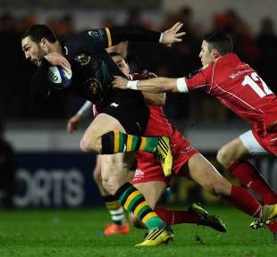 Saints wing George North breaks through the Scarlets centres during the European Rugby Champions Cup match between Scarlets and Northampton Saints at Parc y Scarlets on January 23, 2016 in Llanelli, Wales.