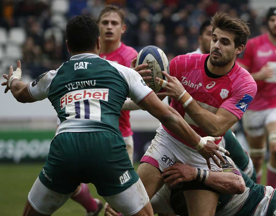 Stade Francais' French fullback Hugo Bonneval tries to break through the Leicester defence