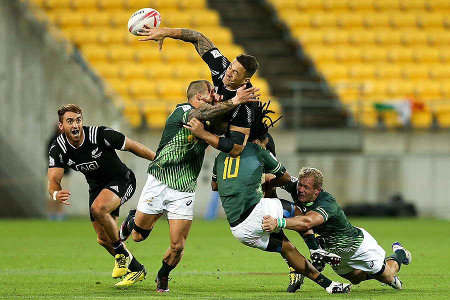 New Zealand's Sonny Bill Williams is tackled by three Blitzbok defenders during their Pool A