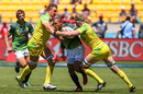 Siaosi Asofolau of Samoa is tackled by Tom Cusack and Stephan van der Walt of Australia during the 2016 Wellington Sevens cup quarter-final