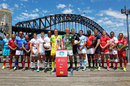 The captains of all 16 teams competing at the Sydney Sevens pose in front of the Harbour Bridge