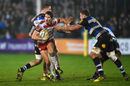 James Hook of Gloucester Rugby evades Stuart Hooper of Bath Rugby