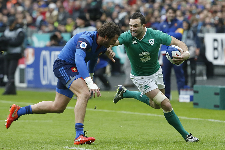 France's fullback Maxime Medard (L) prepares to tackle Ireland wing Dave Kearney