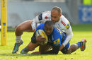 Neville Edwards of Sale Sharks tackled by Olly Woodburn of Exeter Chiefs