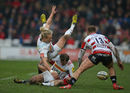 Matt Hopper and Nick Evans of Harlequins lose the ball as they collide