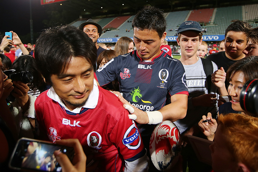 Ayumu Goromaru of the Reds poses with fans and signs autographs after the Super Rugby Pre-Season match between the Reds and the Brumbies
