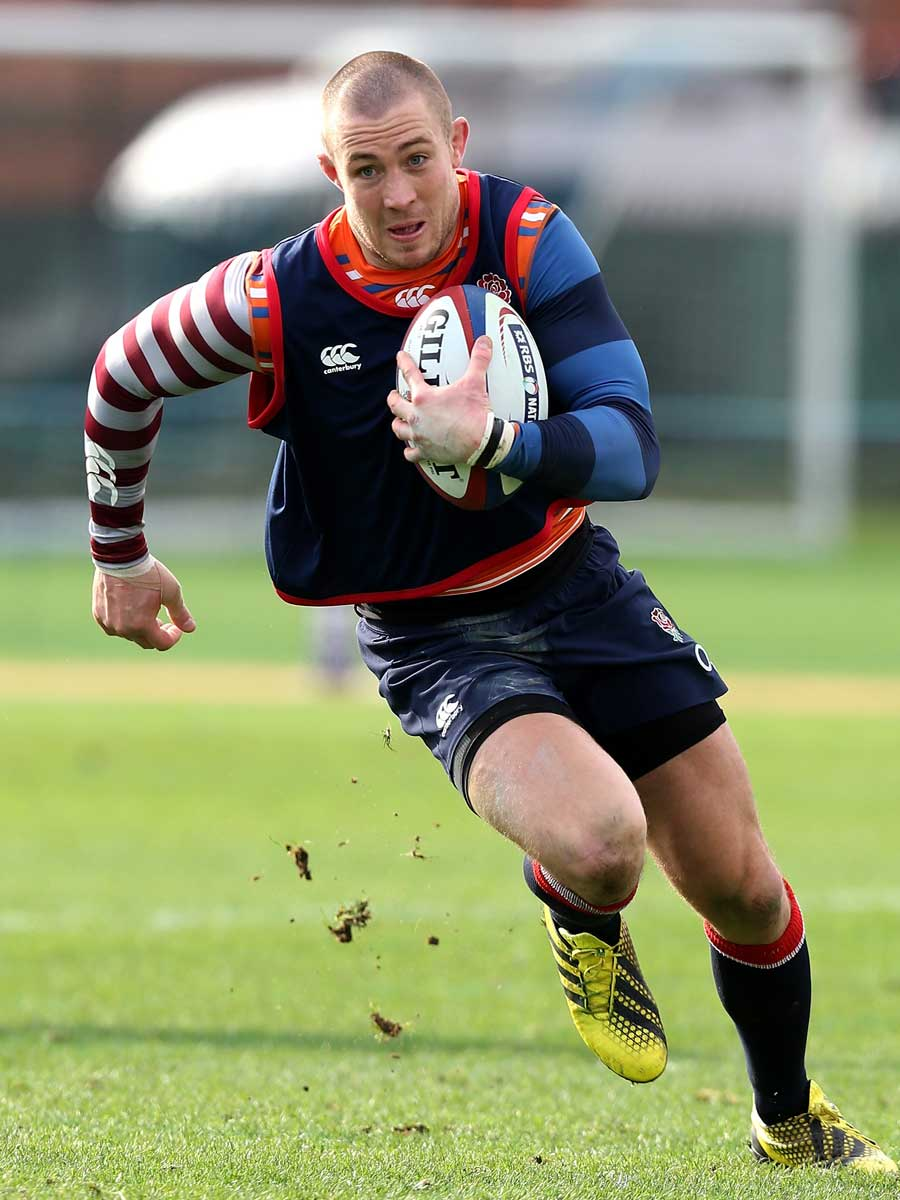 Mike Brown runs with the ball during an England training session