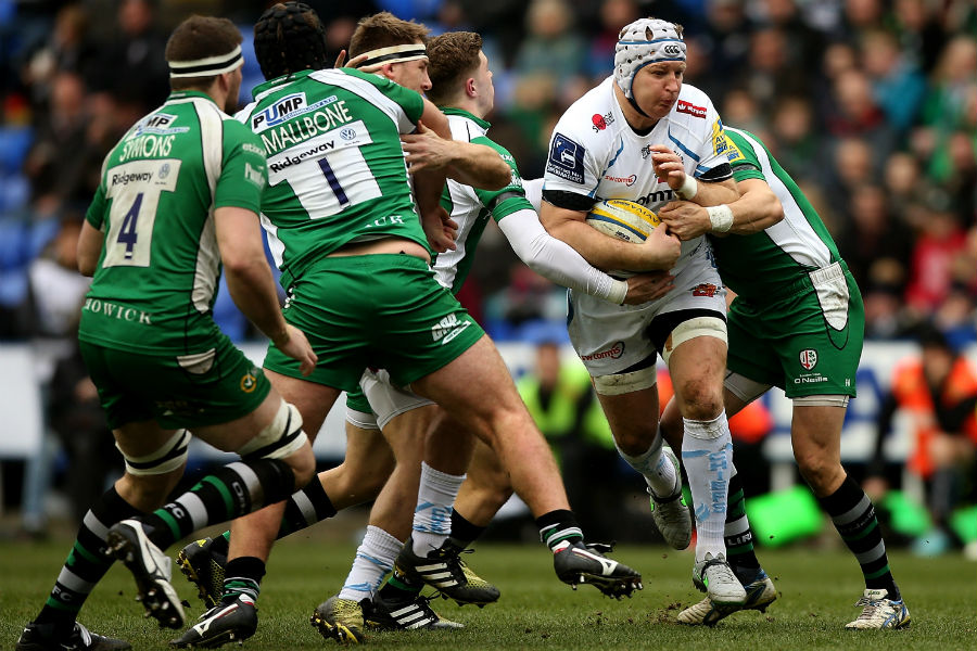 Thomas Waldrom of Exeter is tackled by Johnny Williams