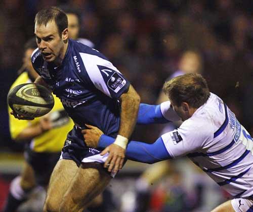 Sale's Charlie Hodgson breaks through the Bath defence