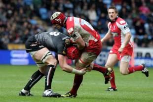Gloucester's Alasdair Strokosch is tackled by the Ospreys' Alun Wyn Jones