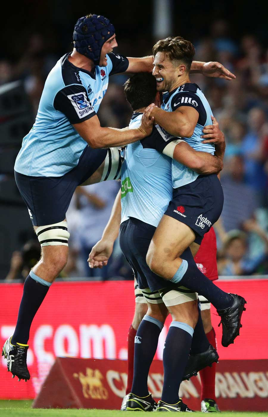 The Waratahs' David Horwitz (right) celebrates his try with Dean Mumm and team-mates