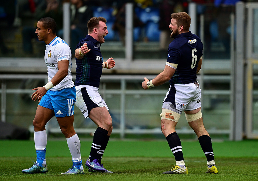 John Barclay of Scotland (r) celebrates scoring his side's first try with Stuart Hogg