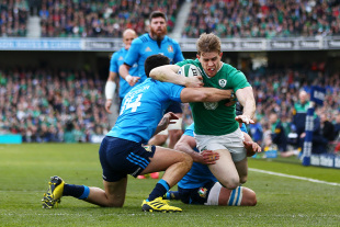 DUBLIN, IRELAND - MARCH 12: Andrew Trimble of Ireland dives to score their first try during the RBS Six Nations match between Ireland and Italy at Aviva Stadium on March 12, 2016 in Dublin, Ireland.  (Photo by Michael Steele/Getty Images)