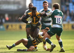COVENTRY, ENGLAND - MARCH 12: Christian Wade of Wasps is tackled by Mathew Tait of Leicester Tigers during the Aviva Premiership match between Wasps and Leicester Tigers at The Ricoh Arena on March 12, 2016 in Coventry, England.