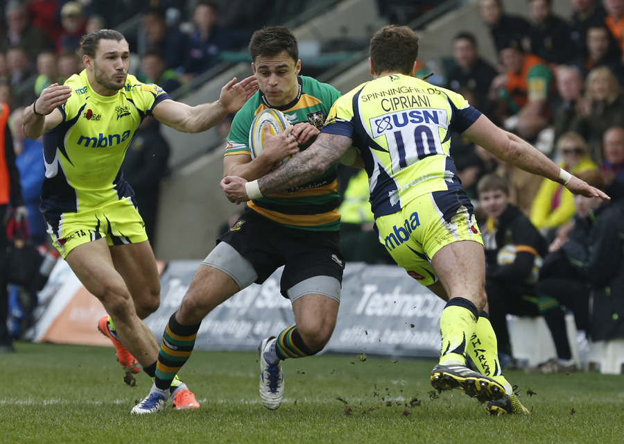 Northampton's Tom Collins runs into the Sale defence.