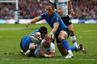 EDINBURGH, SCOTLAND - MARCH 13: Stuart Hogg of Scotland dives through the tackles from Yacouba Camara and Gael Fickou of France to score his team's opening try during the RBS Six Nations match between Scotland and France at Murrayfield Stadium on March 13, 2016 in Edinburgh, Scotland. (Photo by Ian MacNicol/Getty Images)