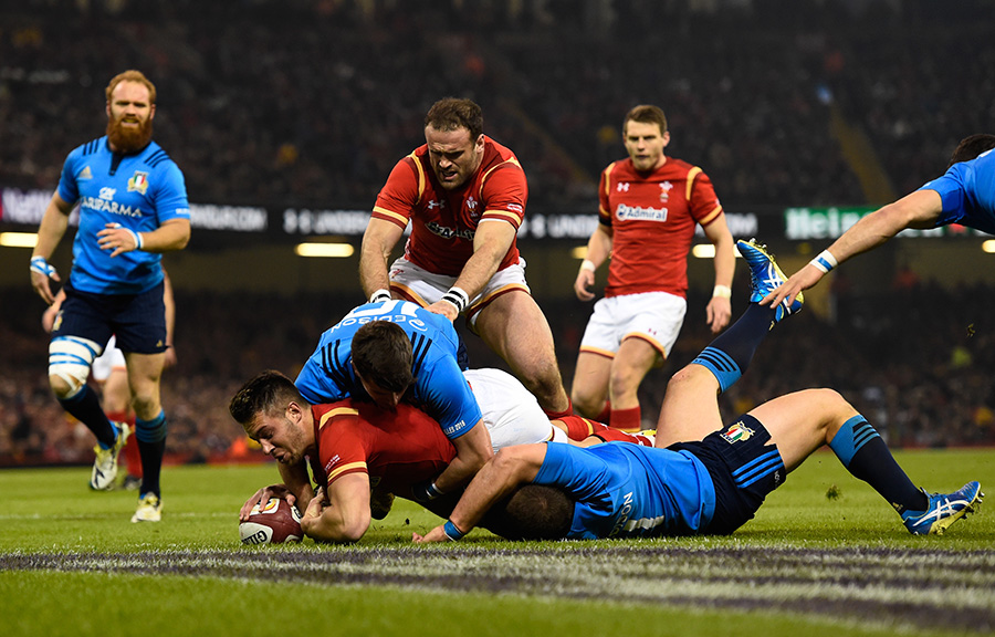 Rhys Webb of Wales crashes over to score the opening try