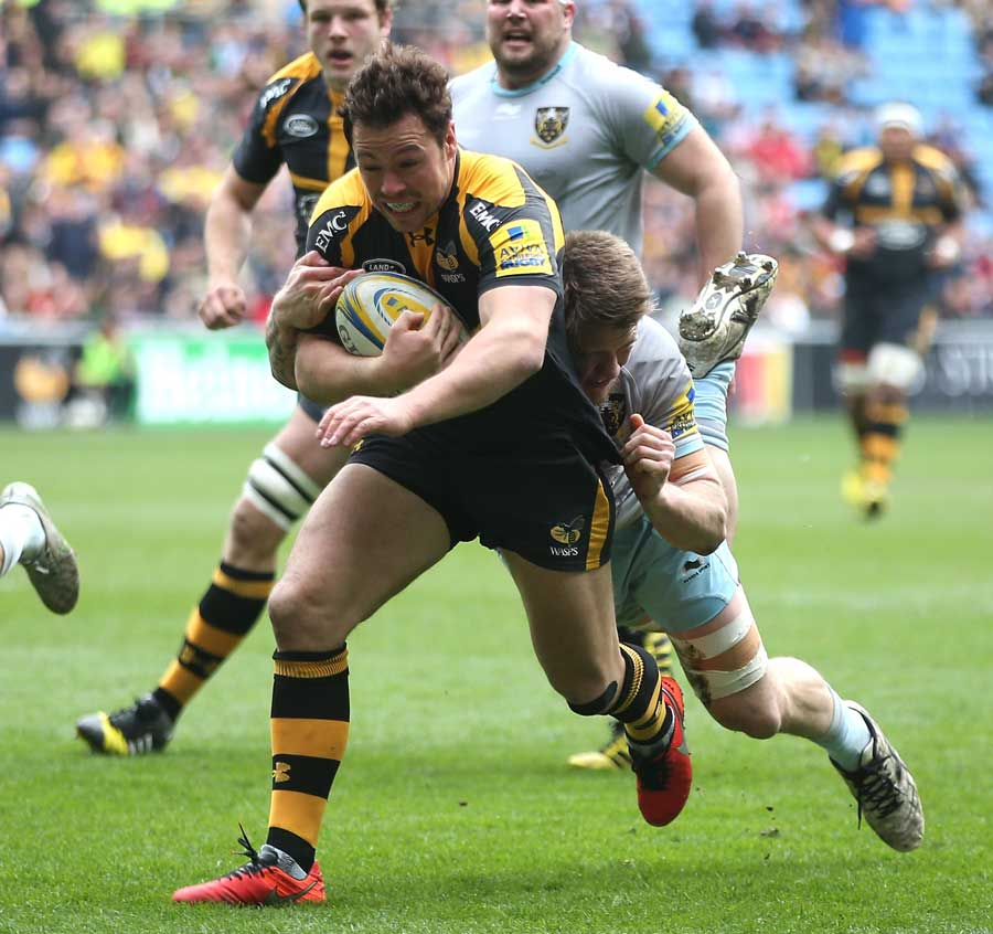 Wasps' Rob Miller is tackled short of the line