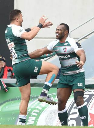 Leicester Tigers' Fijian wing Vereniki Goneva (R) celebrates after scoring a try during the European Champions Cup quarter-final rugby union match between Leicester Tigers Stade Francais at Welford Road stadium in Leicester, central England on April 10, 2016.