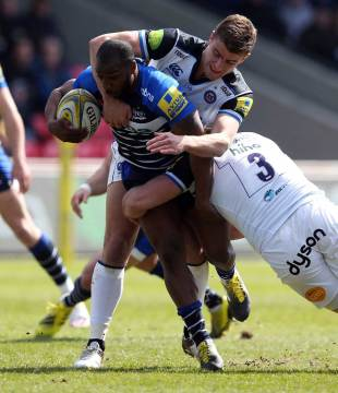 Nev Edwards of Sale Sharks is tackled by Henry Thomas of Bath Rugby during the Aviva Premiership match between Sale Sharks and Bath Rugby at the AJ Bell Stadium on April 17, 2016 in Salford, England. (Photo by Chris Brunskill/Getty Images)
